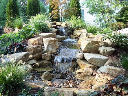 Water features koi ponds waterfalls fountains urn for Design of pondless waterfalls